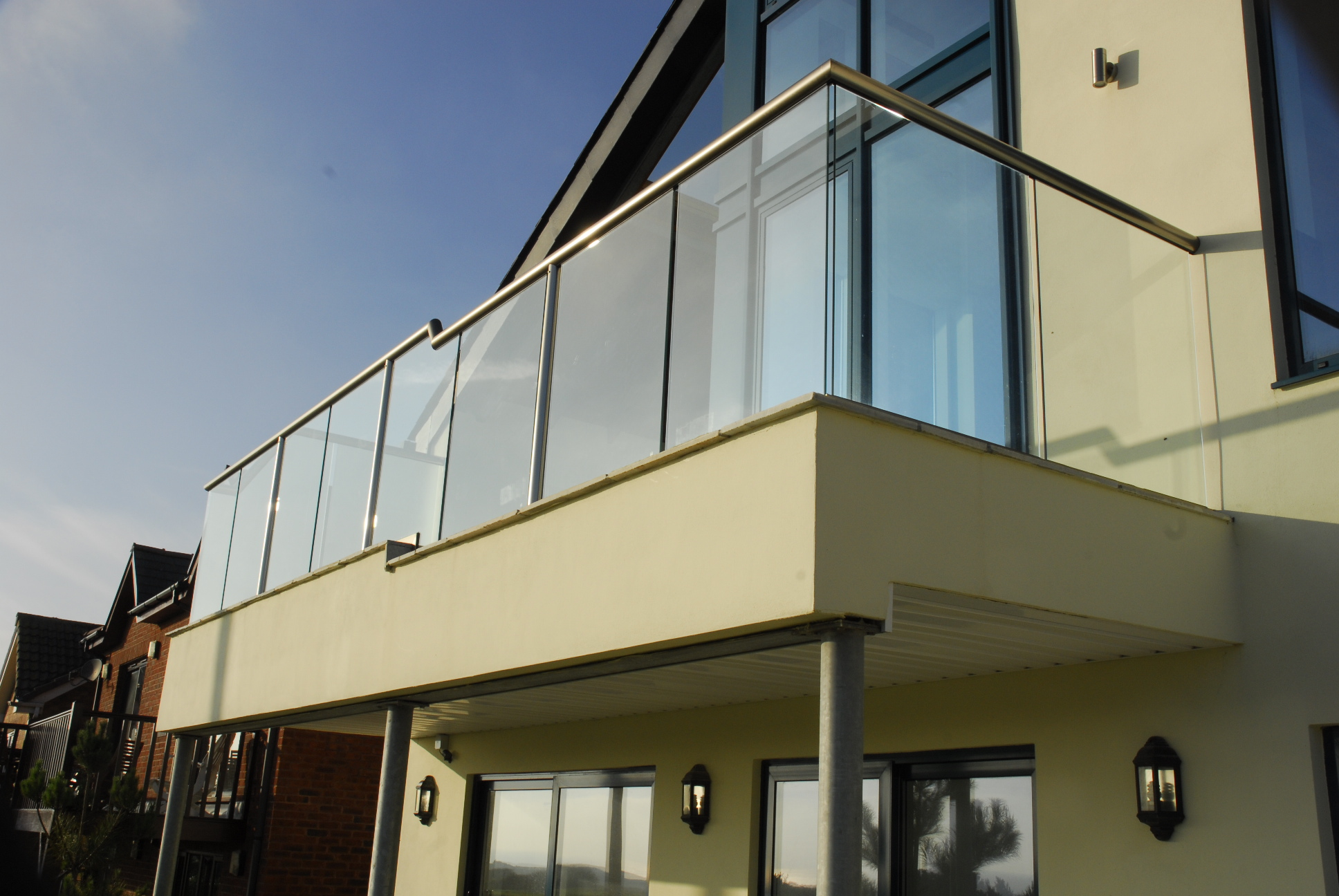Balconies mccann building services for Balcony with glass
